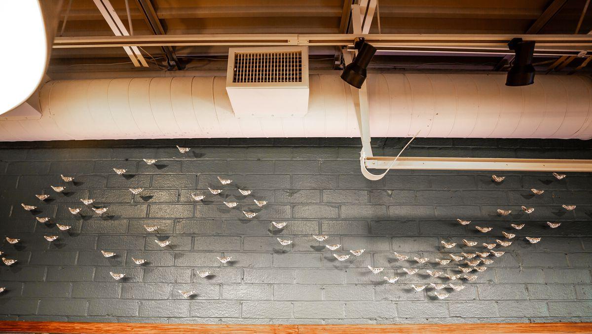 Flock of high fire stoneware clay birds by artist Jenifer Thoem