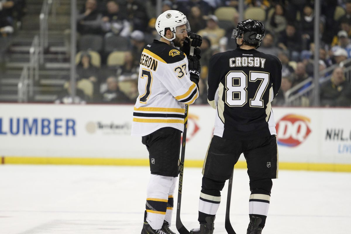 Boston Bruins v Pittsburgh Penguins, Patrice Bergeron speaks with Sidney Crosby during a break in the action.