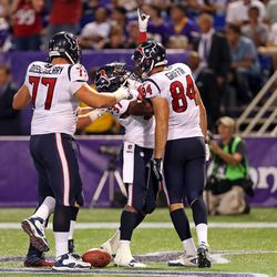 Aug 9, 2013; Minneapolis, MN, USA; Houston Texans running back Ray Graham (37) celebrates with offensive tackle David Quessenberry (77) and tight end Ryan Griffin (84) after scoring a touchdown in the fourth quarter against the Minnesota Vikings. The Texa