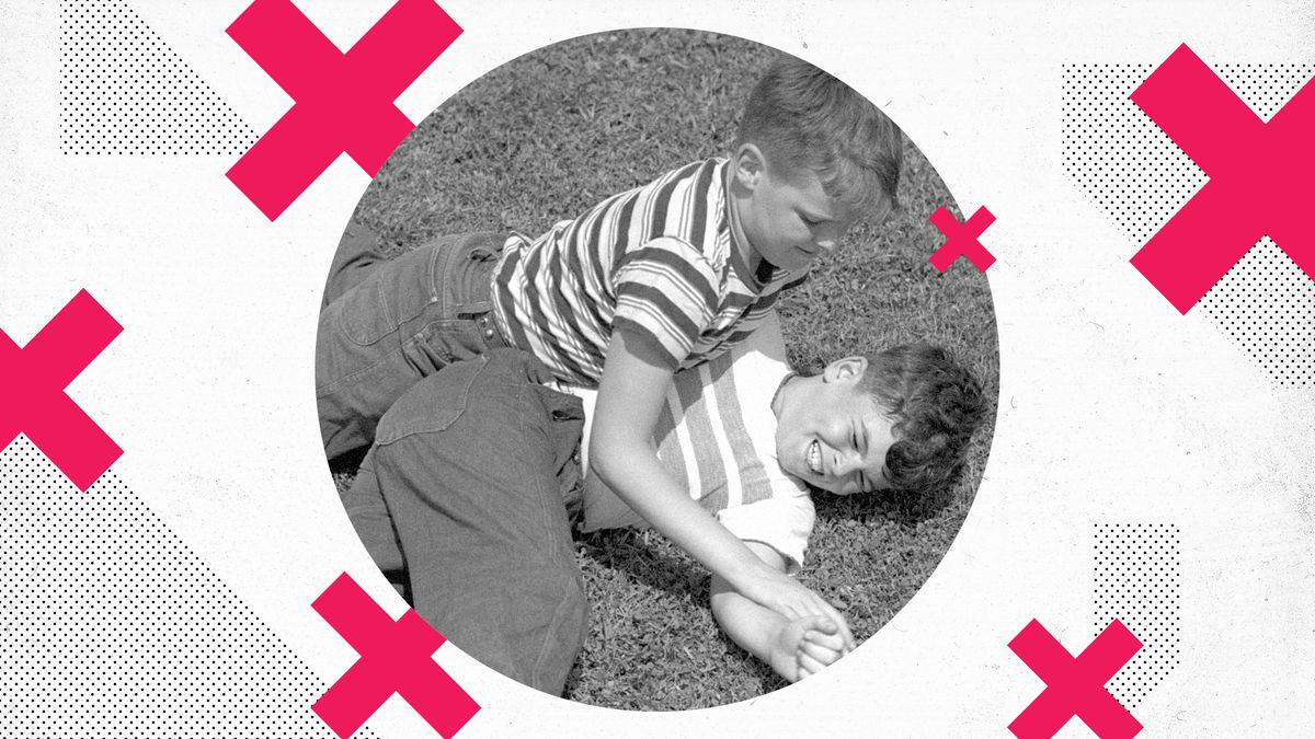 Two young kids wrestling on top of each other. A red X pattern surrounds the photo.
