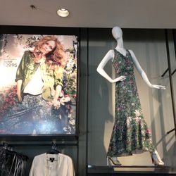 Ads featuring the face of the H&M Conscious Collection, Vanessa Paradis, cover the store walls.
