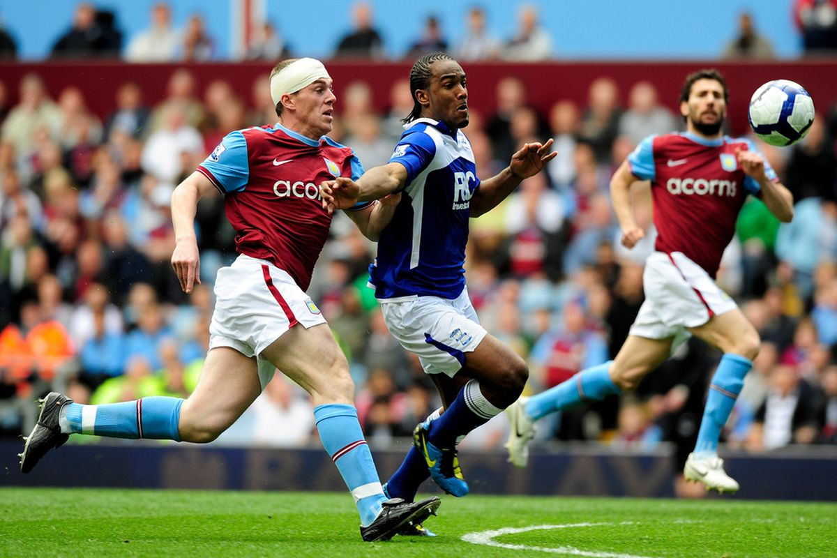 BIRMINGHAM, ENGLAND - APRIL 25: Richard Dunne, after being turned into a zombie, beats a Scum in the Second City Derby while Carlos Cuellar looks on in admiration. (Photo by Jamie McDonald/Getty Images)