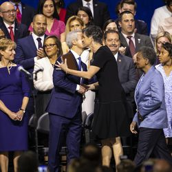 Mayor-elect Lori Lightfoot's wife, Amy Eshleman, hugs Mayor Rahm Emanuel before Lightfoot takes her oath of office during the city of Chicago's inauguration ceremony at Wintrust Arena, Monday morning, May 20, 2019.
