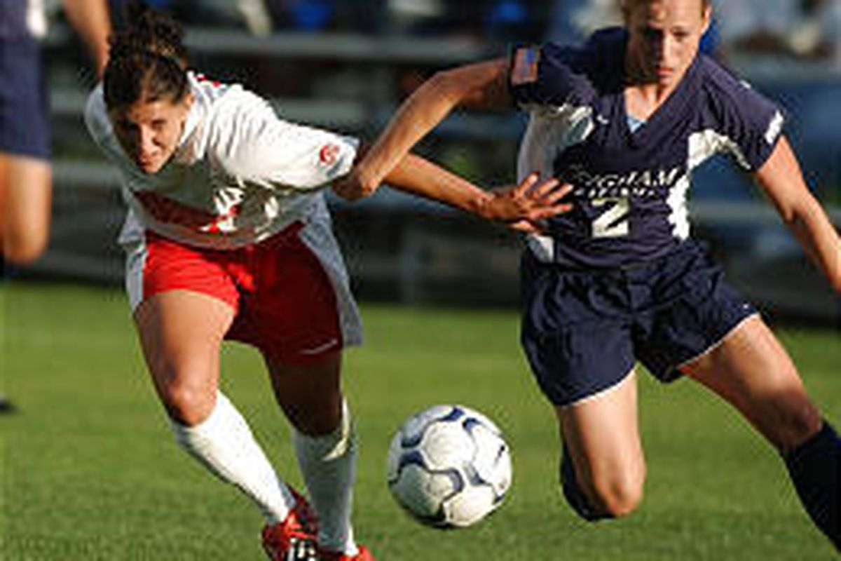 Southern Utah's Ashley Smith, left, and BYU's Amberlea Anderson battle for the soccer ball Monday at BYU.