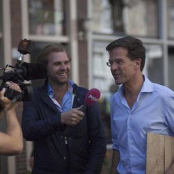 Dutch Prime Minister Mark Rutte is interviewed during a campaign visit four days ahead of the national elections, in Dordrecht, south-western Netherlands, Saturday, Sept. 8, 2012.  With the debt crisis plunging the European Union into the darkest days of its history, many commentators are wondering whether Wednesday's Dutch elections will radically transform their relationship with the EU,  one of the nations that forged unity from the ashes of World War II.