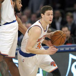 New York Knicks guard Jimmer Fredette brings the ball up court during the fourth quarter of an NBA basketball game against the Toronto Raptors Monday, Feb. 22, 2016, at Madison Square Garden in New York. The Raptors won 122-95.