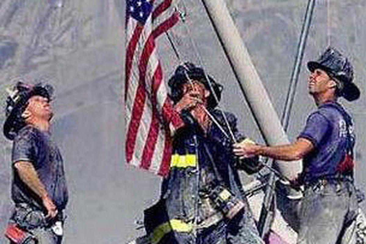 "via <a href=""http://firecritic.com/files/2009/09/9-11_firefighters_w_flag.jpg"">firecritic.com</a>"