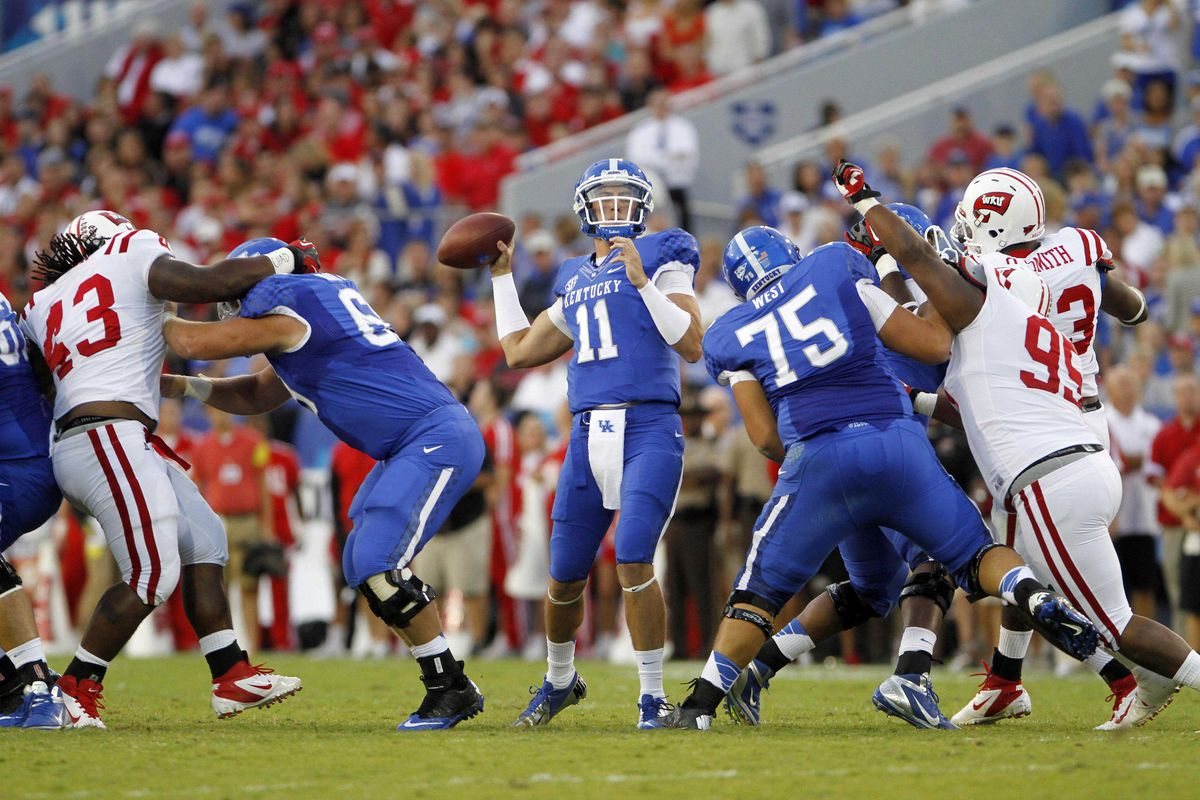 Sept 15, 2012; Lexington, KY, USA; Kentucky WIldcats quarterback Maxwell Smith (11) throws the ball against the Western Kentucky Hilltoppers at Commonwealth Stadium. Credit: Mark Zerof-US PRESSWIRE