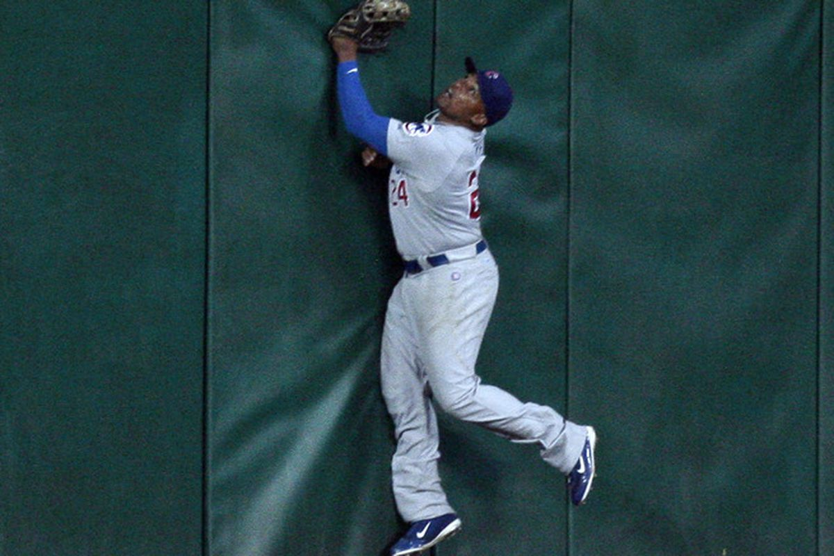 Centerfielder Marlon Byrd of the Chicago Cubs looks up as Brian Bogusevic of the Houston Astros hits a walk-off  grand slam in the ninth to defeat the Chicago Cubs 6-5 at Minute Maid Park in Houston, Texas.  (Photo by Bob Levey/Getty Images)