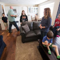 Trey and Heidi Wallis with their kids, Bubba, Sam, Louie and Ellie at their Bluffdale home on Wednesday, Nov. 2, 2016. Heidi Wallis and her husband, Trey, are fighting to have GAMT screening placed on the national newborn screening list. Louie and Sam have the rare disease guanidinoacetate methyltransferase (GAMT) deficiency.