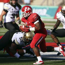 Fresno State's Robbie Rouse rushes past Colorado defenders in the first quarter of an NCAA college football game in Fresno, Calif., Saturday, Sept. 15, 2012.
