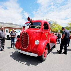 Firefighters at Fire Station No. 51 in Layton admire a restored 1939 firetruck that was used at Kennecott Copper in the '40s and restored for Shriner's Hospital for Children as organizers of the Sounds of Freedom Festival delivered Little Caesars Pizzato the first responders on Friday, May 15, 2020. Festival organizers dropped off pizzas at the Davis County Sheriff's Office, the Farmington Fire Department, and the Layton and Clearfield fire departments.