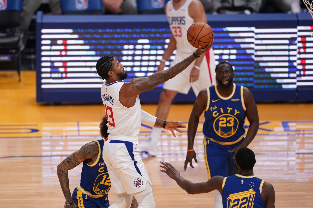 Los Angeles Clippers forward Paul George (13) misses a shot in the lane against the Golden State Warriors in the first quarter at the Chase Center.