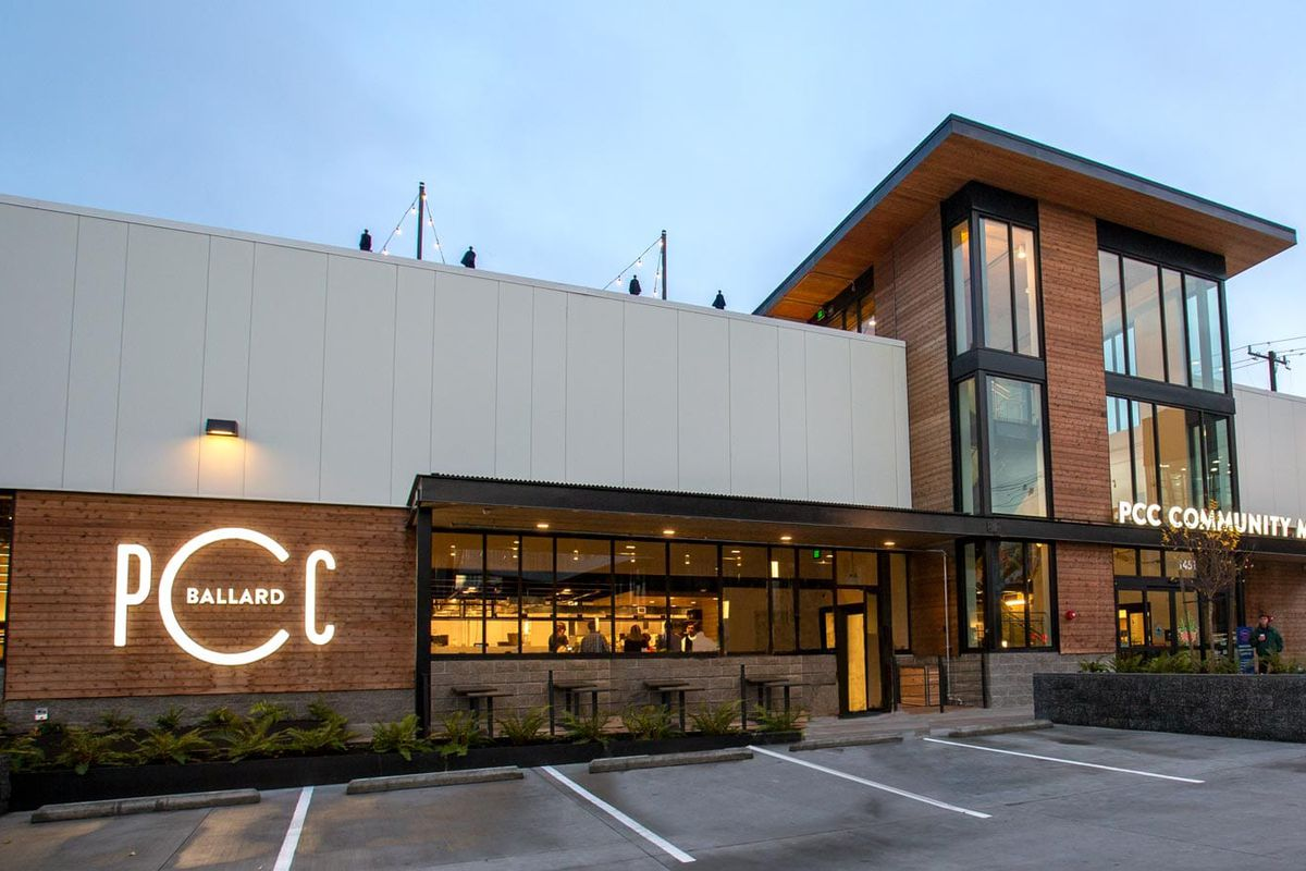 The storefront of the PCC Community Markets store in Ballard at twilight