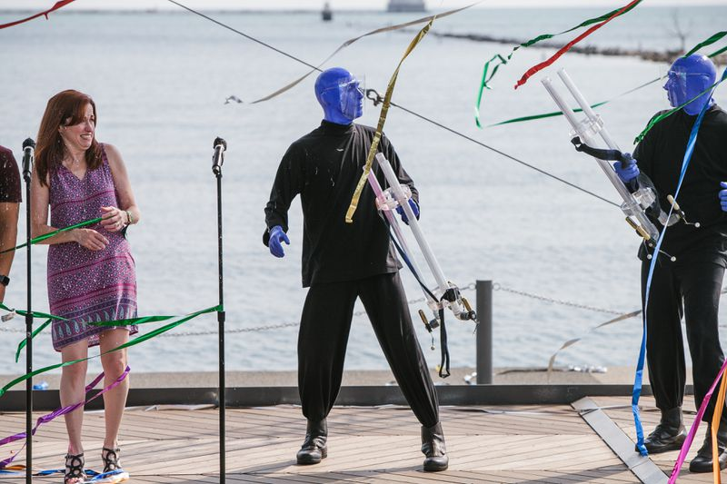The Blue Man Group made a surprise appearance Tuesday, shooting ribbons all over the Lake Stage and into the crowd.