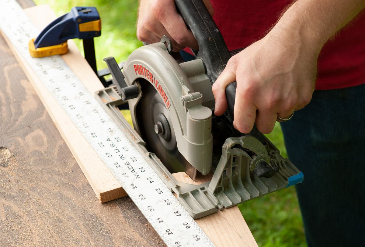 Man Makes Cuts For Feet And Brackets With Circular Saw