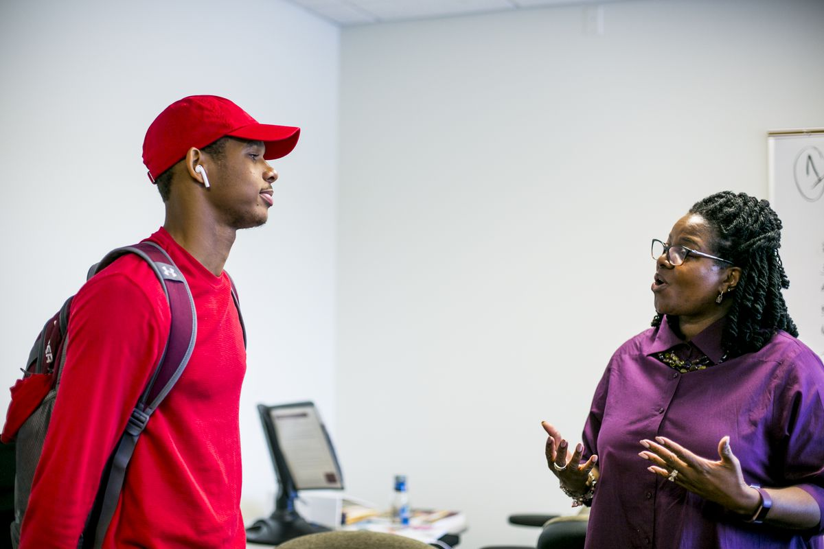 Demetrius Robinson, a freshman at Central Michigan University from Detroit, chats with Mary Henley, who heads a program that helps first generation and low income students succeed on campus.