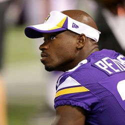 Aug 9, 2013; Minneapolis, MN, USA; Minnesota Vikings running back Adrian Peterson (28) looks on from the sidelines during the third quarter against the Houston Texans at the Metrodome. The Texans won 27-13.