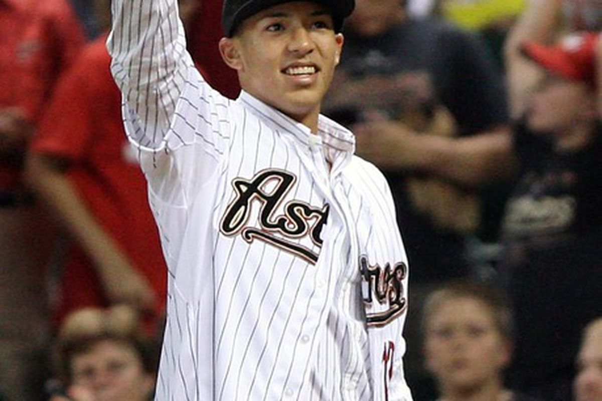 June 07, 2012; Houston, TX, USA; Houston Astros draft pick Carlos Correa waves to the crowd during a game against the St. Louis Cardinals at Minute Maid Park. Mandatory Credit: Troy Taormina-US PRESSWIRE