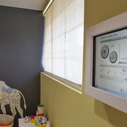 The touch monitor for the facility's solar panels displays how much energy is being saved and generated.