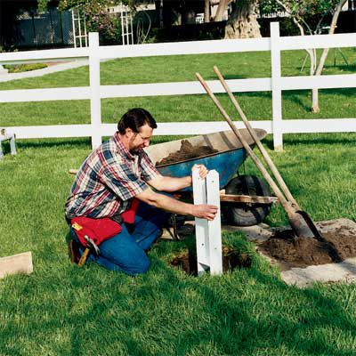 Man Digging Foundation Hole For Flagpole