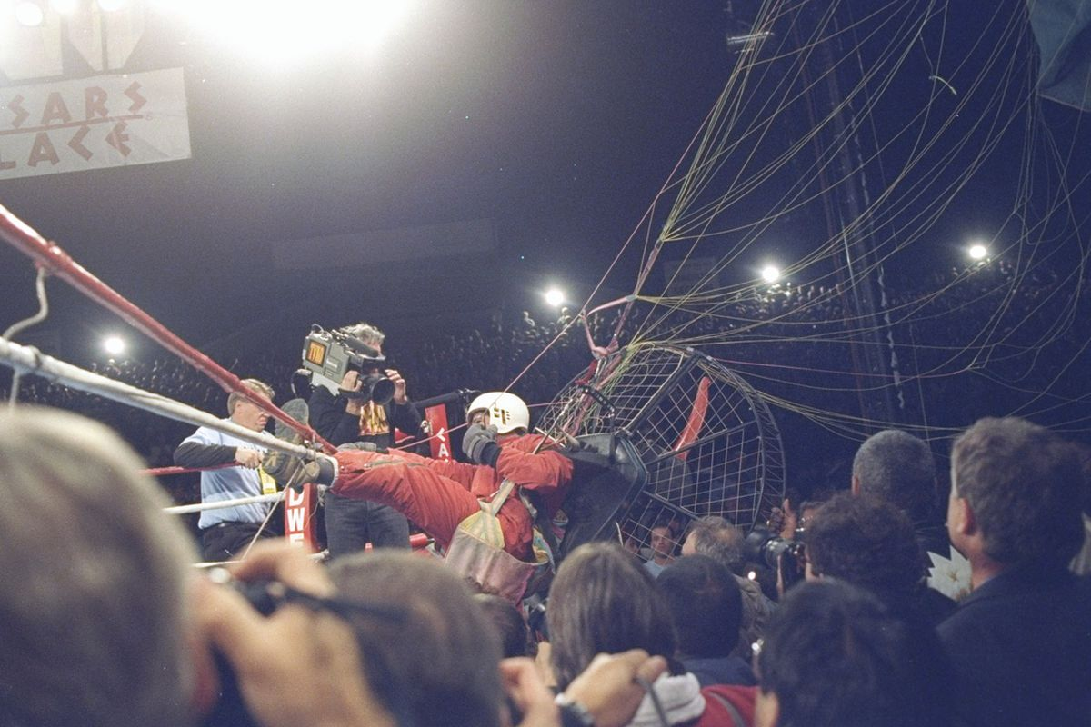 Image result for riddick bowe vs evander holyfield parachute