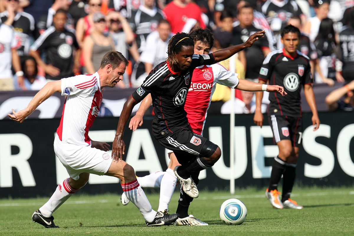 WASHINGTON, DC - MAY 22: Joseph Ngwenya #11 of D.C. United controls the ball against Andre Ooijer #13 of Ajax at RFK Stadium on May 22, 2011 in Washington, DC. (Photo by Ned Dishman/Getty Images)