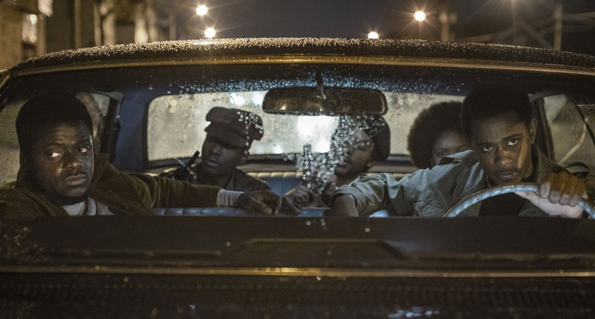 Lakeith Stanfield, Daniel Kaluuya, and a group of Black Panthers in a car at night in Judas and the Black Messiah