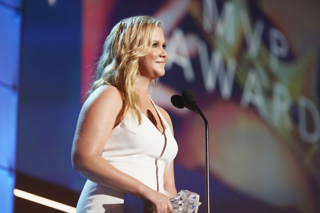 Actress-writer Amy Schumer accepts Critics' Choice MVP Award at the 21st Annual Critics' Choice Awards on January 17, 2016 in Santa Monica, California. (Photo by Christopher Polk/Getty Images