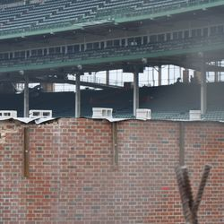 Cinderblocks on top of the left-field inner wall holding something down