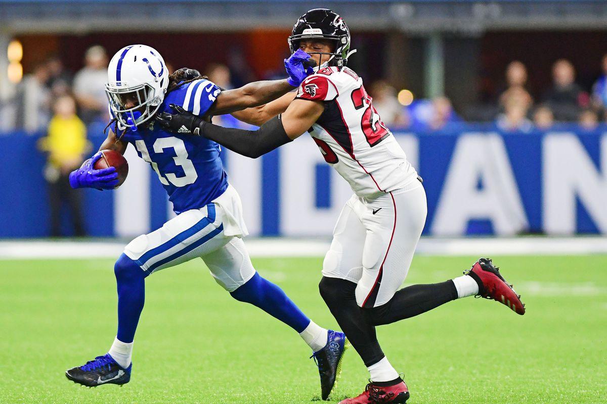 Indianapolis Colts receiver T.Y. Hilton stiff arms Atlanta Falcons cornerback Jordan Miller in the first quarter at Lucas Oil Stadium.