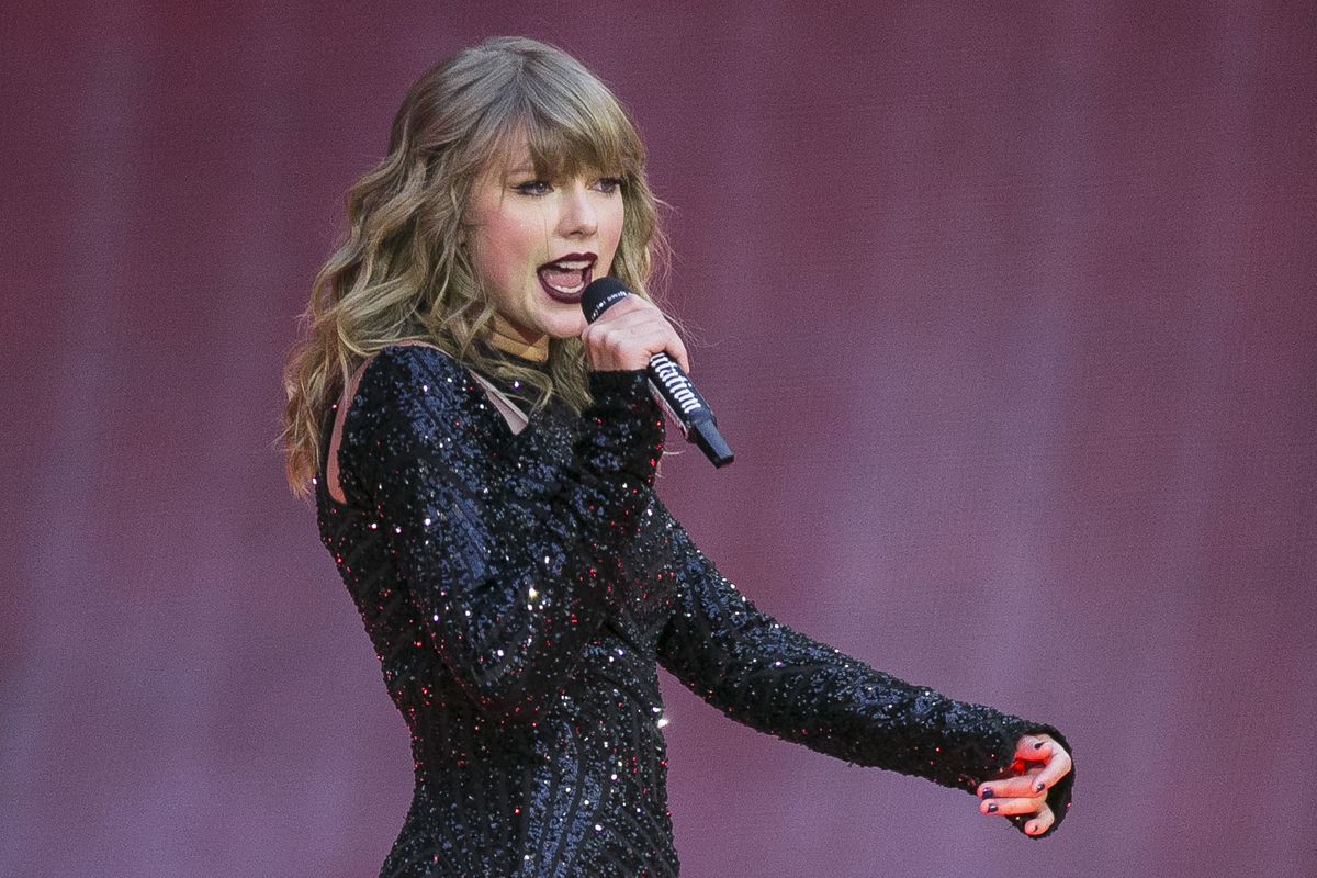 In this June 22, 2018, file photo, singer Taylor Swift performs on stage in concert at Wembley Stadium in London. Swift posted on Instagram on Sunday, Oct. 7, that she's voting for Tennessee's Democratic Senate candidate Phil Bredesen, breaking her long-s