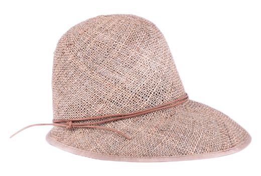 A rustic straw hat with a leather string