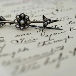 Victorian sterling silver and pearl arrow brooch, $95