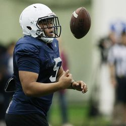 Brigham Young Cougars RB Ula Tolutau (5) tosses the ball after a run during BYU football alumni day practice in Provo on Friday, March 31, 2017.
