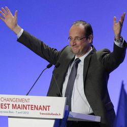 French Socialist Party candidate for the 2012 presidential elections Francois Hollande, acknowledges applause as he arrives for a meeting in Aulnay-sous-Bois, a eastern suburb of Paris, Saturday, April 7, 2012.