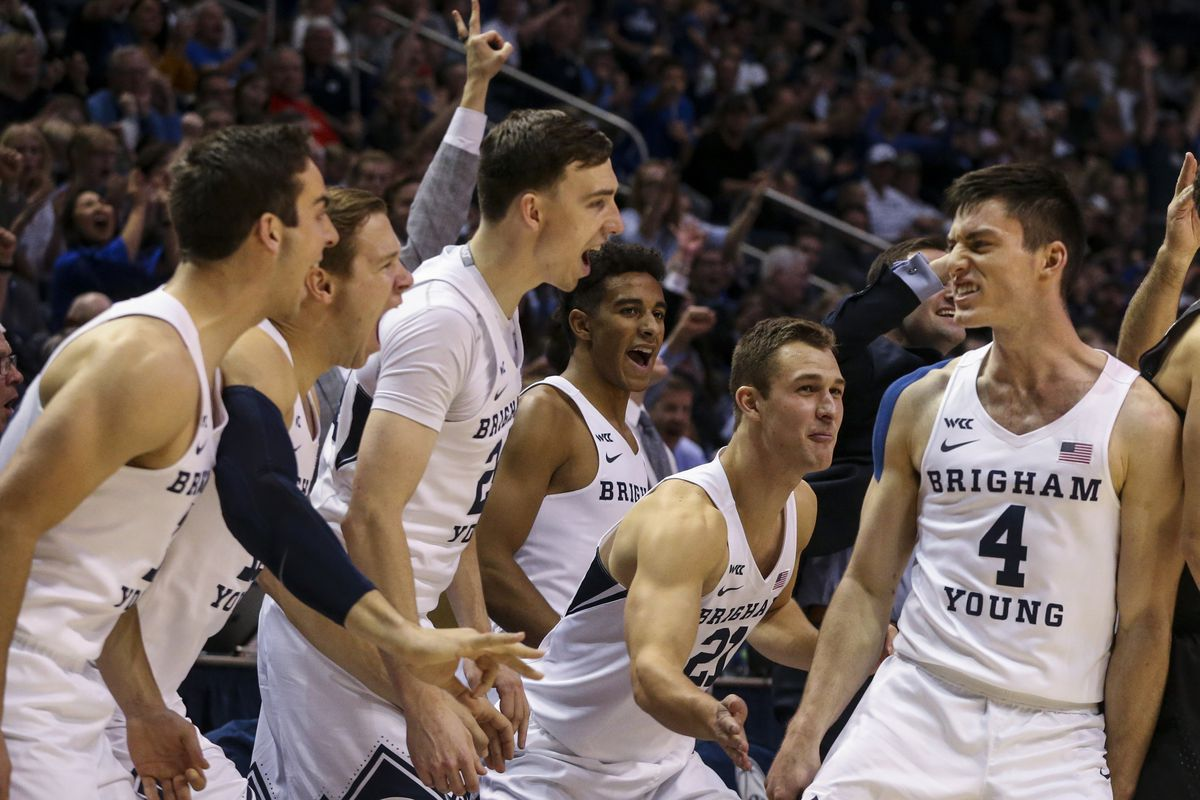 Brigham Young Cougars guard Alex Barcello (4) celebrates with the bench after sinking three during the second half of an NCAA basketball game at Marriott Center in Provo on Saturday, Nov. 9, 2019.