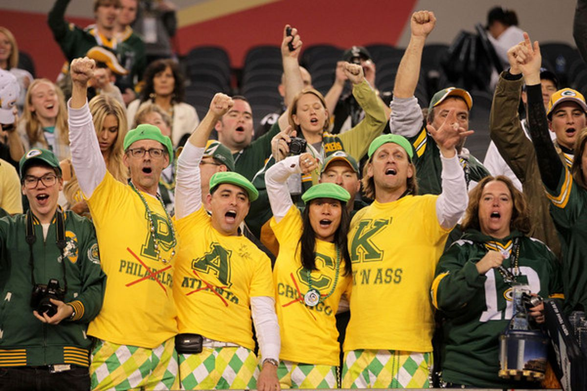 ARLINGTON TX - FEBRUARY 06:  Green Bay Packers fans celebrate after they defeated the Pittsburgh Steelers 31 to 25 in Super Bowl XLV at Cowboys Stadium on February 6 2011 in Arlington Texas.  (Photo by Doug Pensinger/Getty Images)