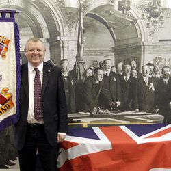 Orange Order Grand Secretary   Drew Nelson, stands beside an old photograph of the signing of the Ulster Covenant.  The Orange Order held a press conference Wednesday, Sept. 26, 2012, where the Orange Order announced that Saturday's Ulster Covenant celebration were tens of thousands of Protestants will parade in Belfast to mark the centenary of the signing of the Ulster Covenant.  The parade organised by the Grand Orange Lodge of Ireland is expected to be the largest demonstration witnessed in Northern Ireland.  The covenant was signed in 1912 to oppose Irish Home Rule.