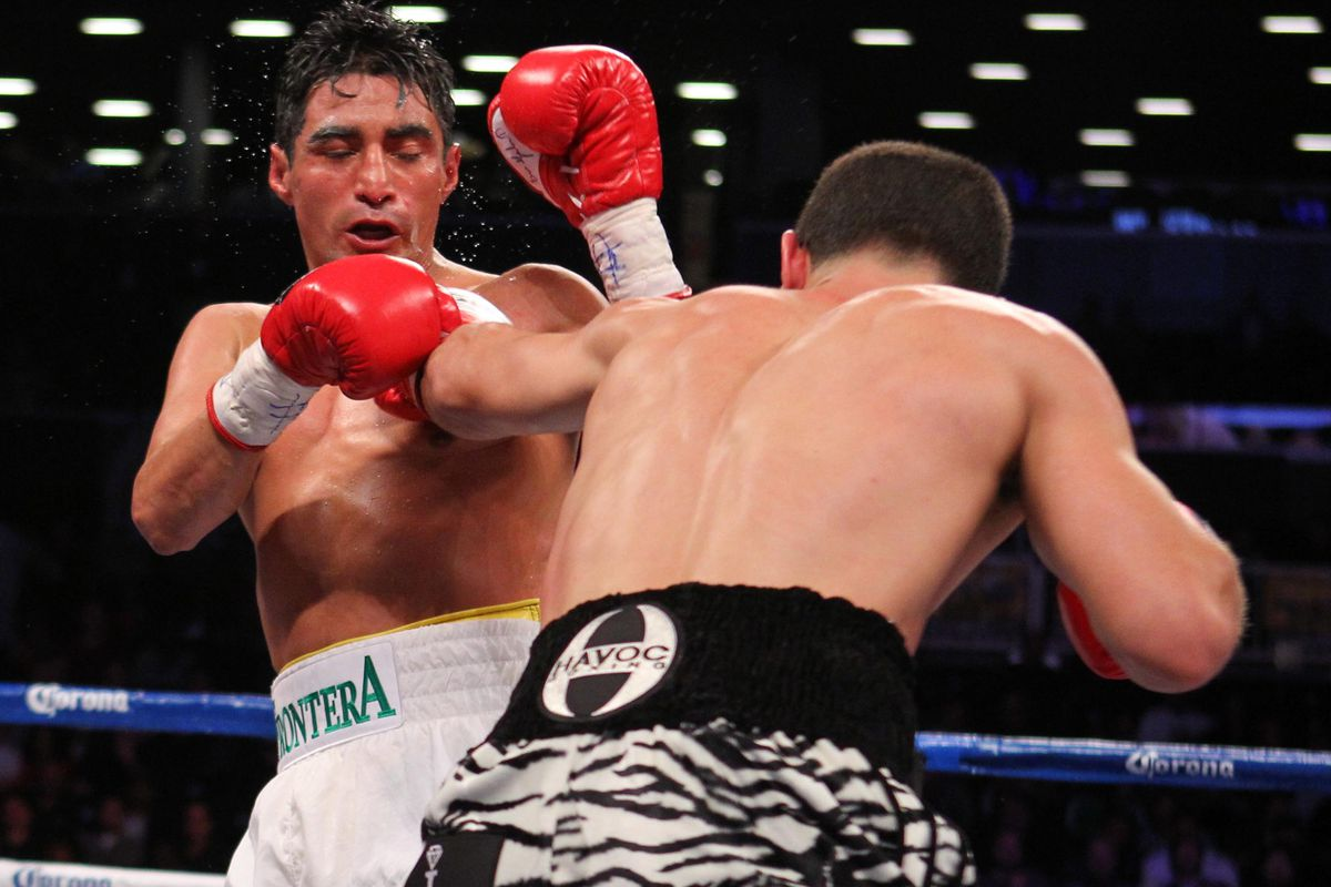 Danny Garcia (zebra trunks) and Erik Morales (white trunks) during Saturday's main event at the Barclays Center.