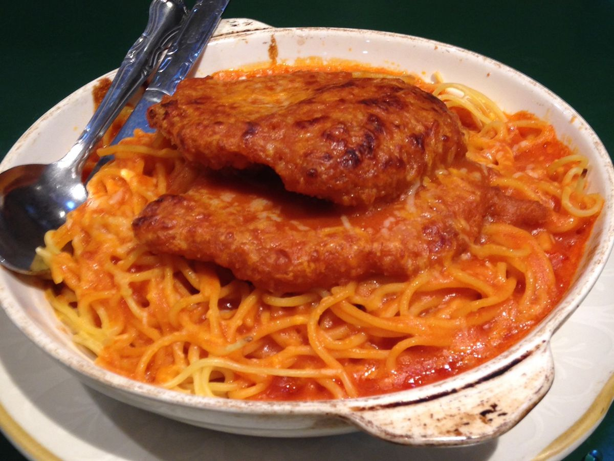Baked pork chop and spaghetti with red sauce at HK Home Kitchen