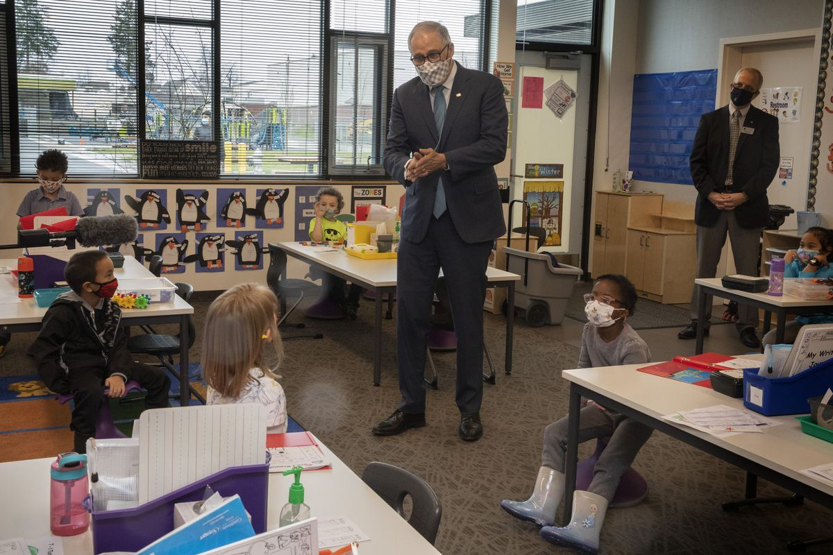 Washington Gov. Jay Inslee speaks with kindergartners in Chelsea Singh's class during a visit to Firgrove Elementary School in Puyallup, Wash., Thursday, Feb. 18, 2021.