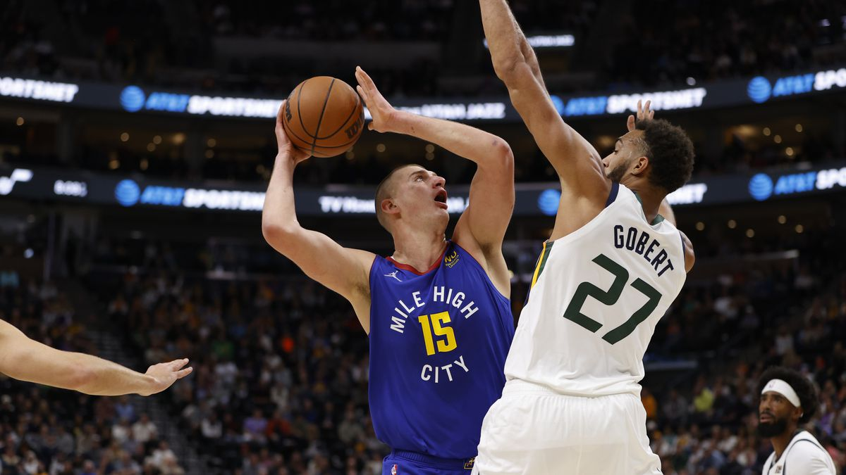 Nikola Jokic #15 of the Denver Nuggets shoots the ball during the game against Rudy Gobert #27 of the Utah Jazz on October 26, 2021 at vivint.SmartHome Arena in Salt Lake City, Utah.