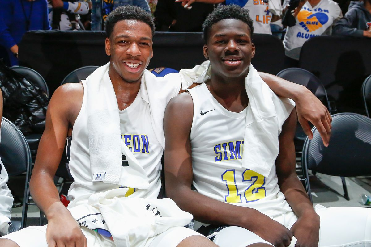 Simeon's Jeremiah Williams (3) and Ahamad Bynum (12) enjoy a moment together after winning the game against Morgan Park.