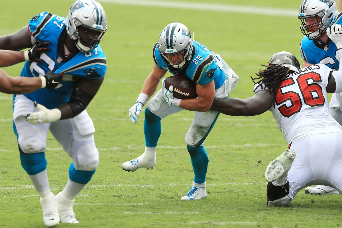 Christian McCaffrey #22 of the Carolina Panthers runs with the ball during the second half against the Tampa Bay Buccaneers at Raymond James Stadium on September 20, 2020 in Tampa, Florida.
