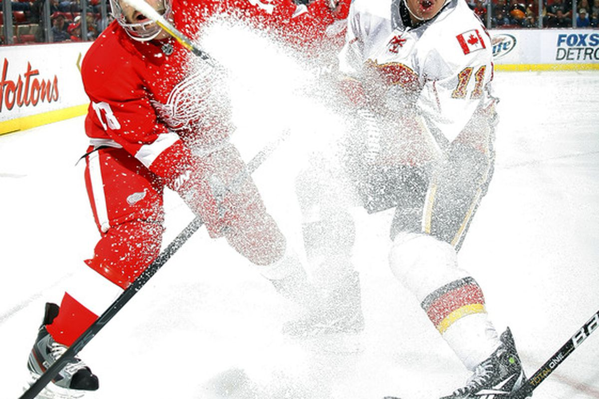 Mikael Backlund's stick explodes into a million pieces while Mickey Redmond curses the material it's made from.