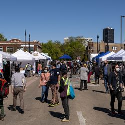Dozens of Andersonville locals visit the Andersonville Farmers Market, Wednesday, May 12, 2021.