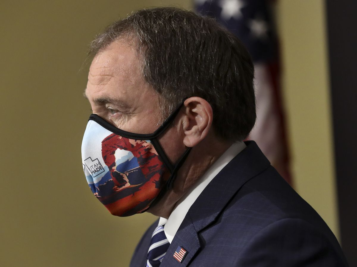 Utah Gov. Gary Herbert wears a Utah-made mask with a depiction of Delicate Arch on it as he begins to speak during the daily COVID-19 briefing at the Capitol in Salt Lake City on Tuesday, April 28, 2020.