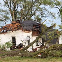 A tree has fallen on a house near Delta, Iowa, on Aug. 10, 2020 due to a derecho.