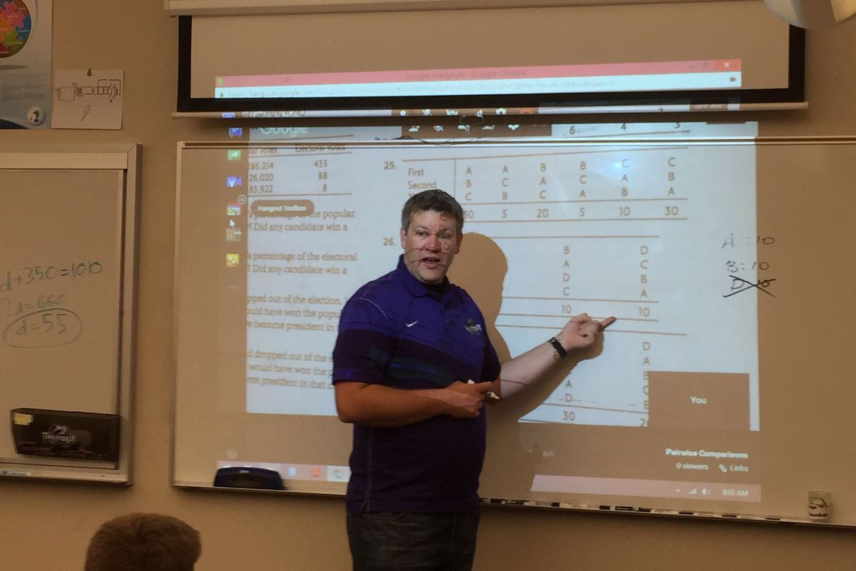 Teacher Jeremy Beckman leads a math lesson at his Colorado Springs school.